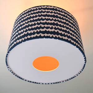 white diffuser with a hole with light on